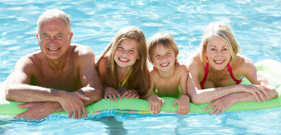 gradnparents enjoy pool with grandchildren